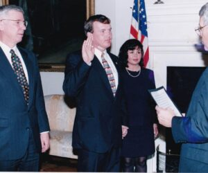 Being sworn in on the Economic Development Commission by Secretary of State John Willis as Governor Glendening looks on