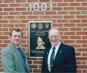 Kevin with his dad at the naming of the Chief Peter J O'Connor Firehouse in Baltimore.  Chief O'Connor served in the department for 40 years and held the top position from 1980--1992